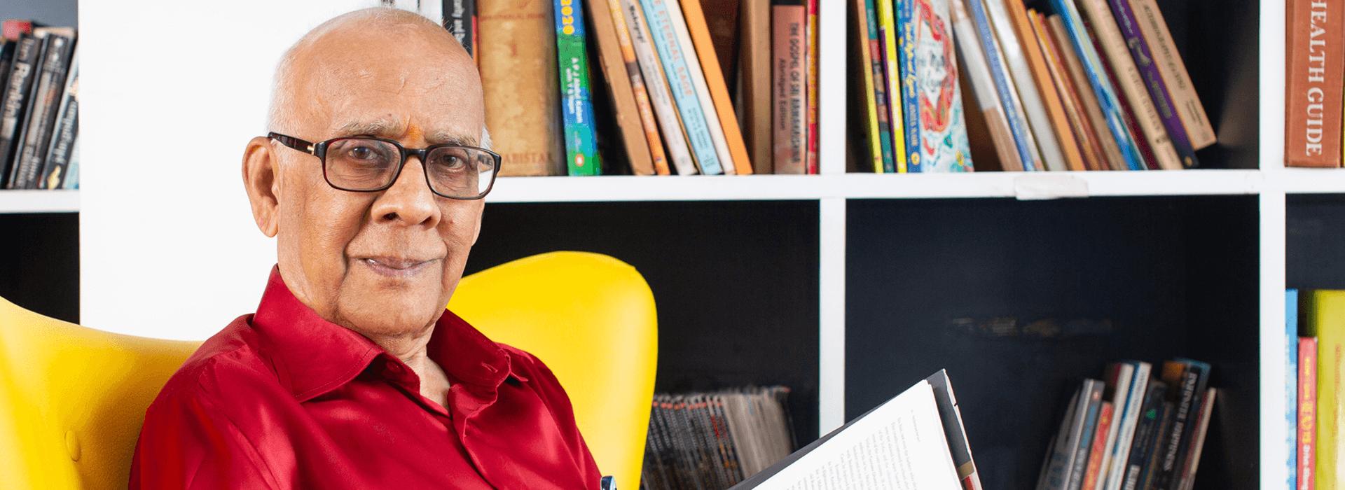 Dr. A Sreekumar Menon, a Serene Urbana resident, spending time in the library